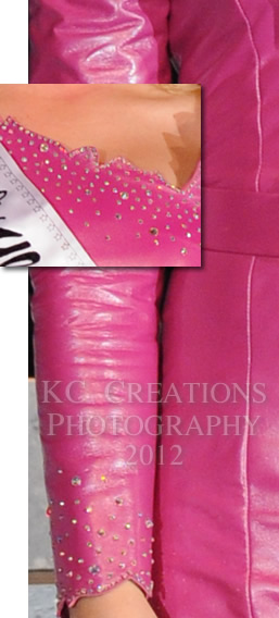 Close-up of Laura Taysom's fuchsia leather dress