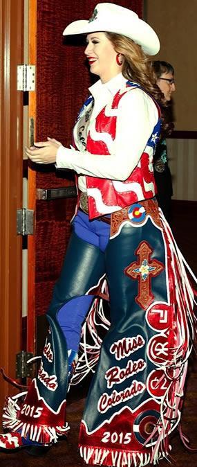 Miss Rodeo Colorado wearing a flag-themed lambskin leather vest