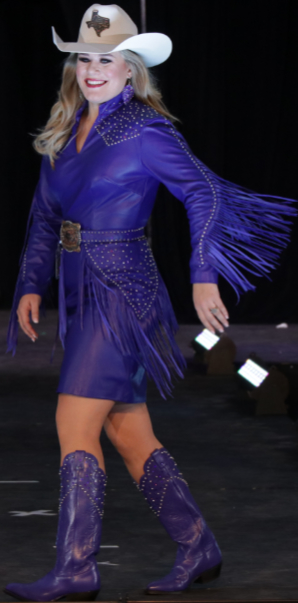 Samantha Cayton, Miss Rodeo Texas, wearing a pearlized navy lambskin suit